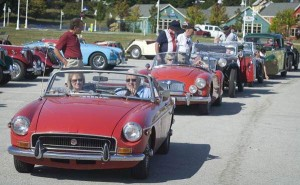 MGB, MGA and T-series cars lined up waiting to move.